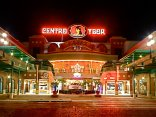 Illuminated two story outdoor mall with large signage for Centro Ybor hanging above signange for Muvico movie theater