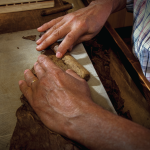 Cigar worker Hand Rolling Cigars