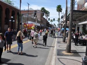 People walking on 7th Avenue during a festival