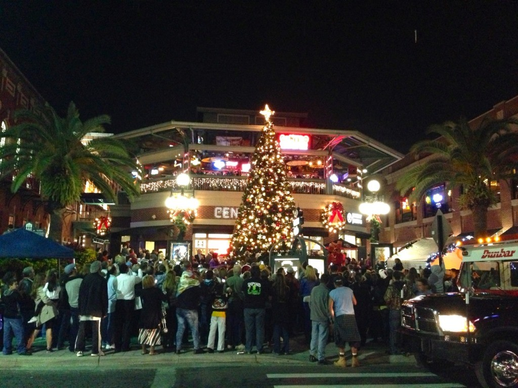 Crowd of people watching the lgihting of the Christmas tree in Centro Ybor