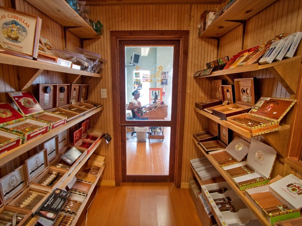 small room full of cigars in cigar boxes