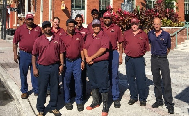 The Ybor Environmental Services Team standing in Centro Ybor