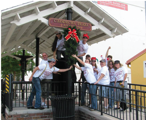 group of people doing community holiday decorations in ybor