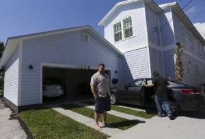 Ybor City Homeowner stands outside of his newly constructed home in Ybor City