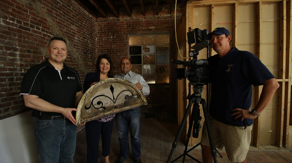 film crew and people holding an antique