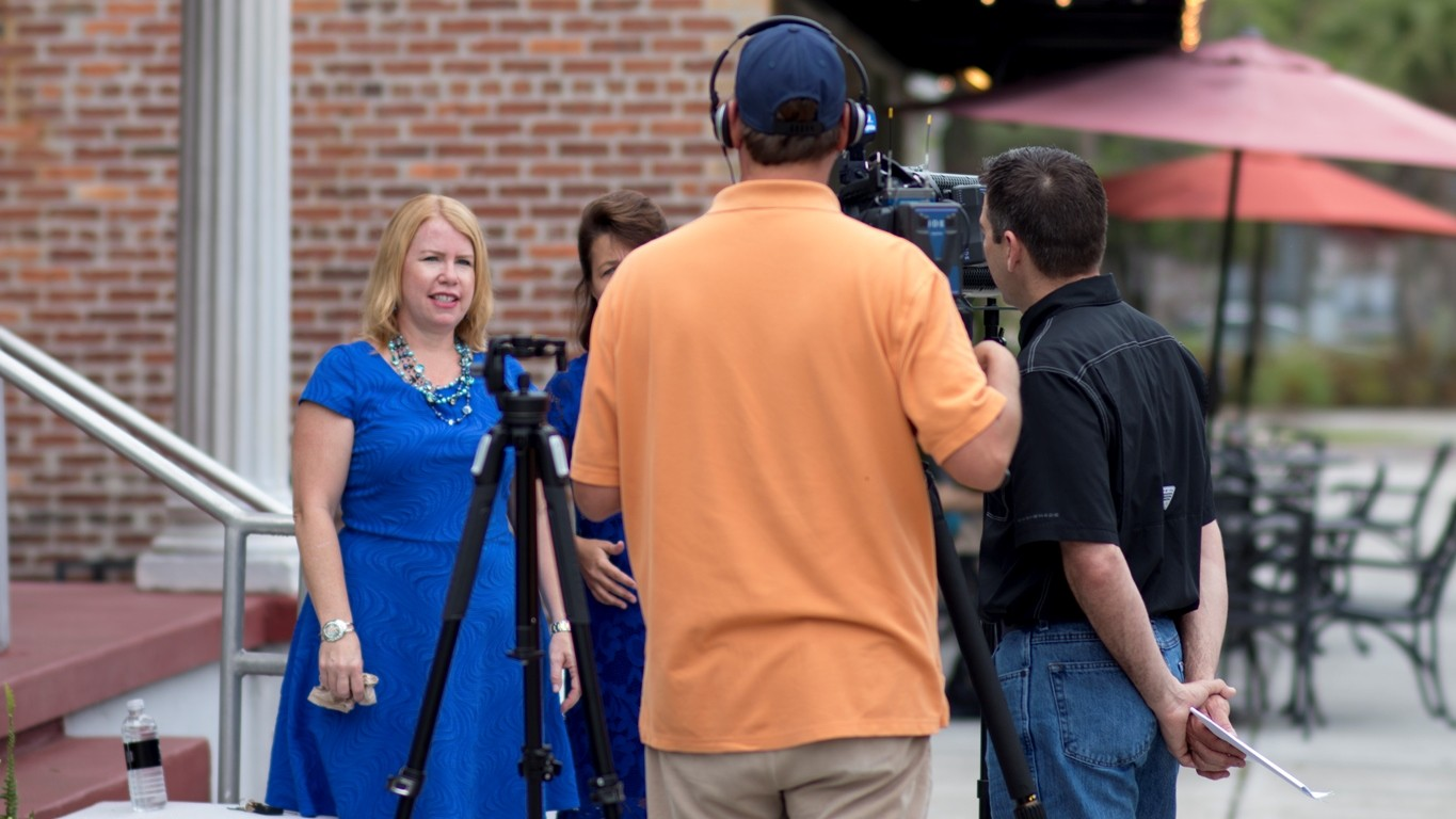 film crew interviewing woman