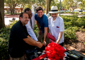 Leo Alvarez, Shawn Robinson, Ryan Swanson, Charlie Miranda cut the ribbon on the newly installed permanent dominoes table in Centennial park in Ybor City