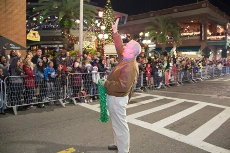 Mayor Bob Buckhorn in front of the Centro Ybor Christmas Tree waving at citizens