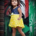 little girl wearing yellow dress