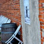 chairs leaning against brick wall