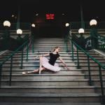 Ballerina posing on stairs