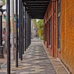 view of ybor sidewalk and brick building