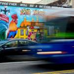 Car and bus passing by the Viva Ybor Mural