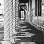 tiled sidewalk with column posts