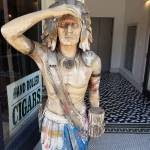 Statue of a Native American holding cigars