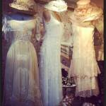vintage white dresses in store window