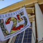 "flag written with ""Celebrating 125 years of L'Unione Italiana Membership"""
