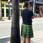 Man wearing kilt standing on 7th avenue