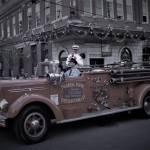 vintage Fire Truck driving down 7th avenue