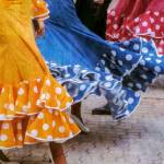 close up of three flamenco dancers twirling skirts