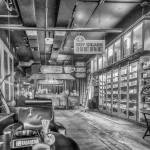 black and white photo of interior of cigar shop