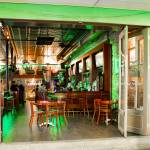 bar interior with people and green lights