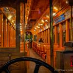 interior of a streetcar with one passenger at night